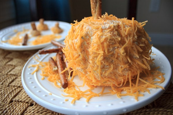 A pumpkin shaped cheese ball that is a perfect appetizer to serve at a Halloween or other Fall-themed event. Super cute and delicious!