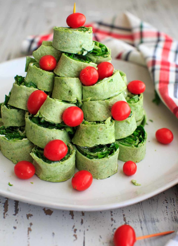 A Christmas tree pita pinwheel appetizer that is an adorable hit for any holiday party. Customizable and easy finger food!