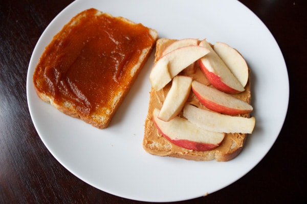 Peanut butter, pumpkin butter, and apple sandwich. A unique, crunchy and flavorful combination for all your autumn cravings.