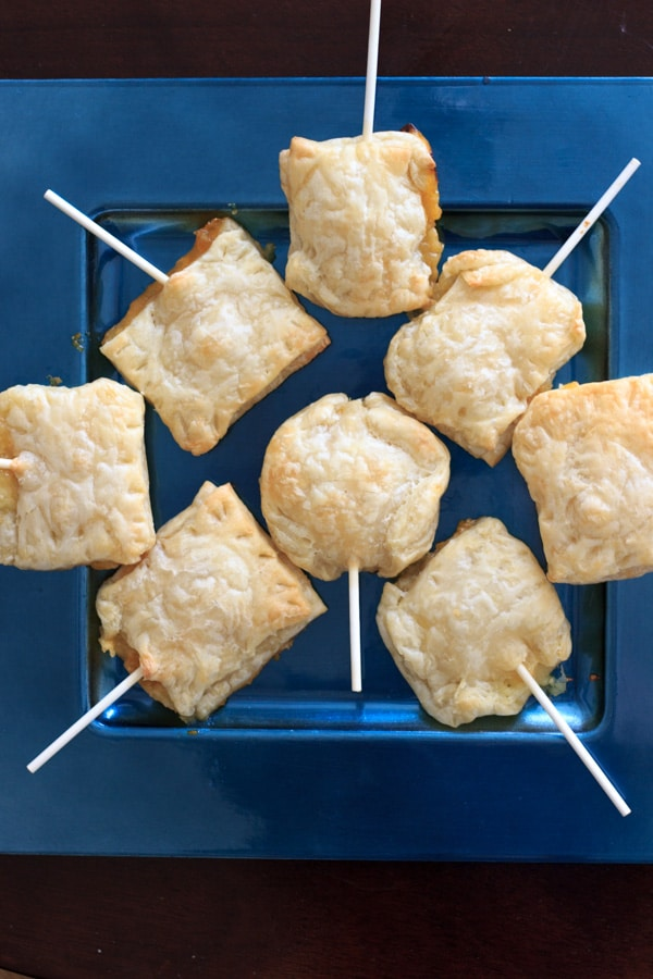 These baked brie pops will be a hit at any gathering! A great alternative to a plain cheese and crackers appetizer.