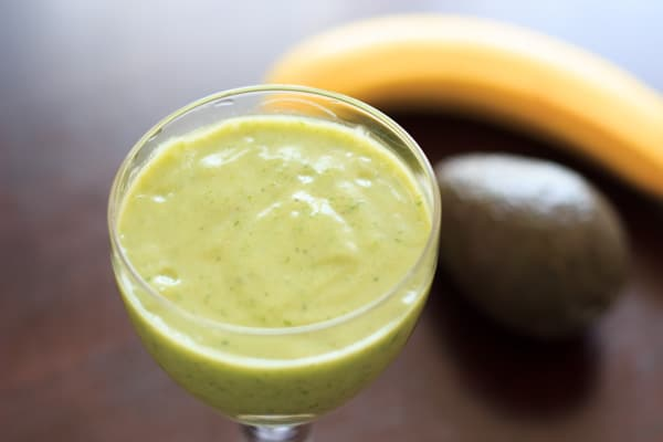 An avocado banana smoothie that is sure to brighten up your day! Creamy, fruity, and oh so good.