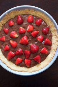 Nutella pudding with a homemade tart crust topped with strawberries. Because fruit + chocolate = healthy dessert!