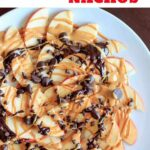 Dessert apple nachos with peanut butter and chocolate drizzle. Fruit, protein and chocolate makes this a delicious vegan and gluten free snack that kids and adults will both love!