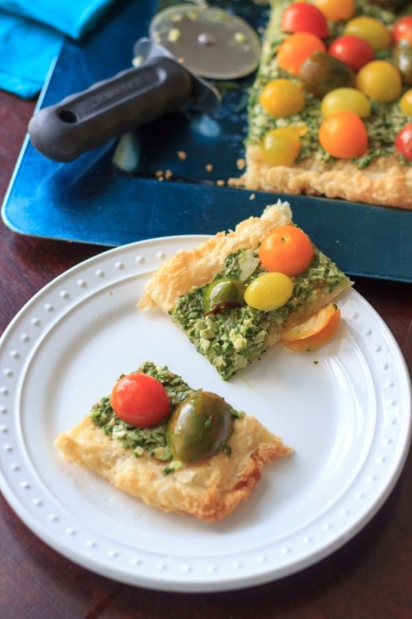 Heirloom tomato tart with homemade puff pastry, vegan pesto, and heirloom tomatoes. Delicious! @trialandeater