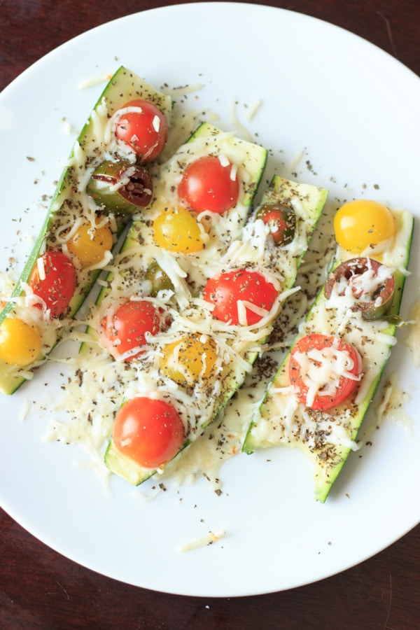 Quick and easy zucchini boats - a healthy meal or snack ready in 5 minutes! Endless options for toppings!