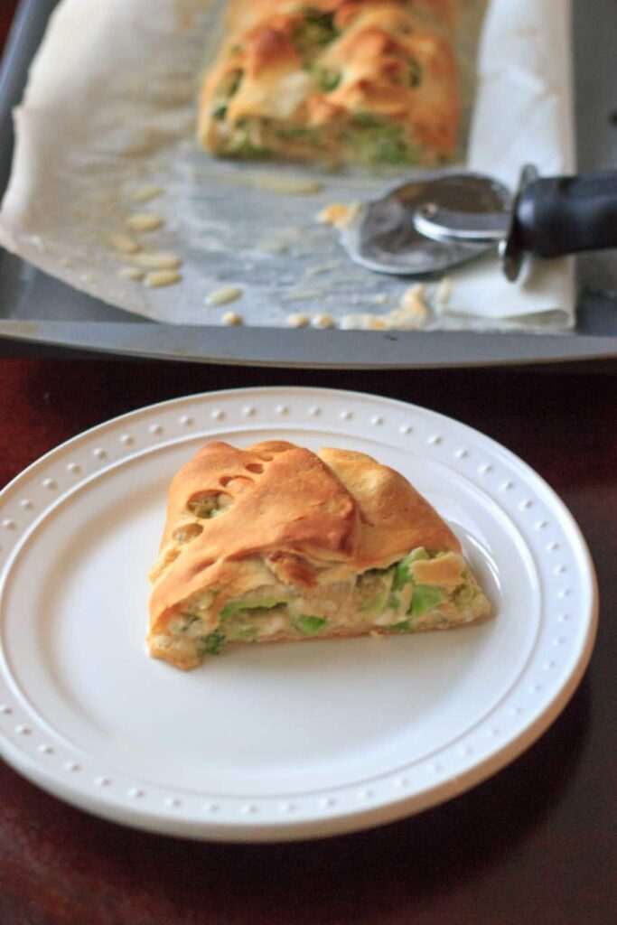A slice of broccoli crescent wrap on a plate