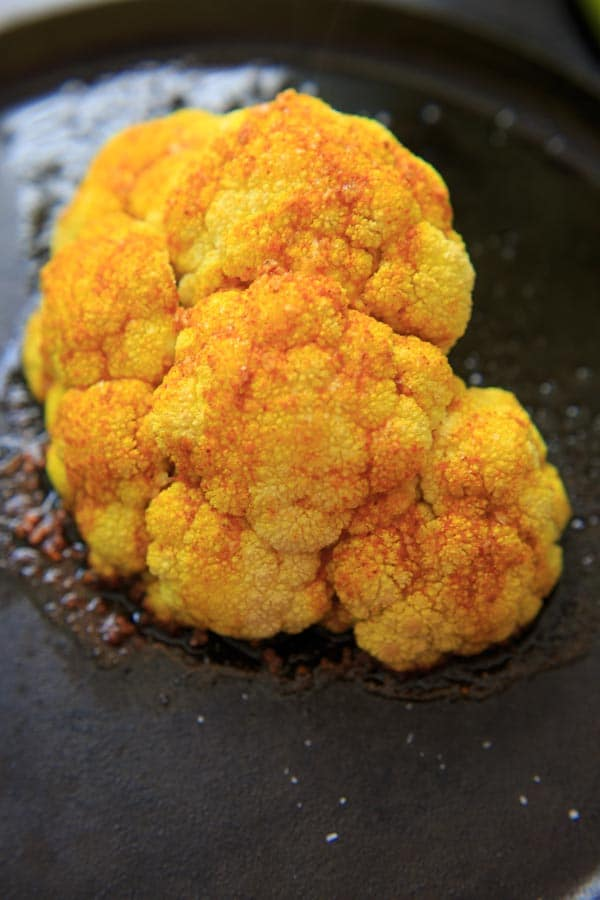 turmeric roasted cauliflower on cast iron