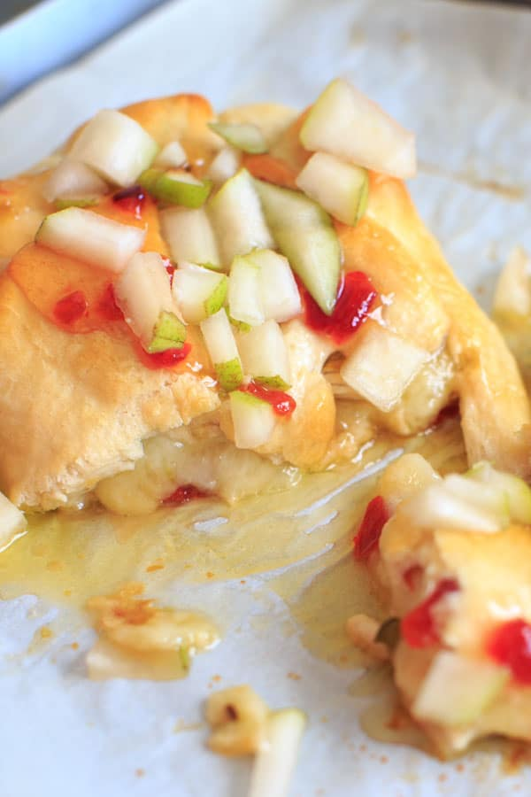 Indulge a little with this Baked Brie with Sweet Hot Pepper Jelly and Pear. Hot and sweet, creamy with a little crunch and a whole lot of deliciousness. Served as an appetizer or dessert, it is sure to be a crowd pleaser.
