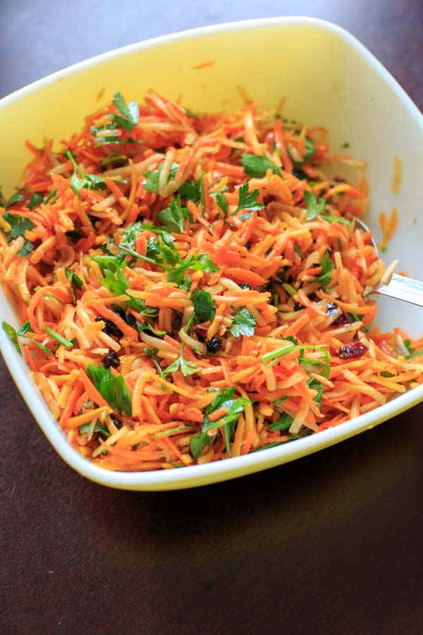 Multicolored Shredded Carrot Salad with dried cranberries, dried blueberries and parsley. A beautiful and healthy side dish that is vegan and gluten free.