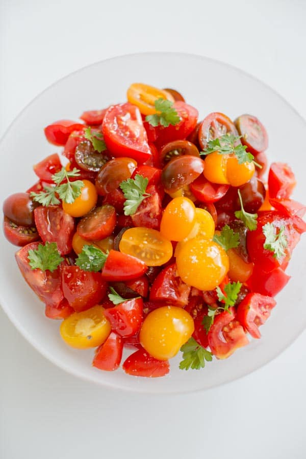 Simple Summer Tomato Salad. Healthy, light, delicious and portable so you can pack it to-go for all your summer adventures.
