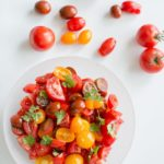 Simple Summer Tomato Salad. Healthy, light, delicious and portable so you can pack it for all your summer adventures.