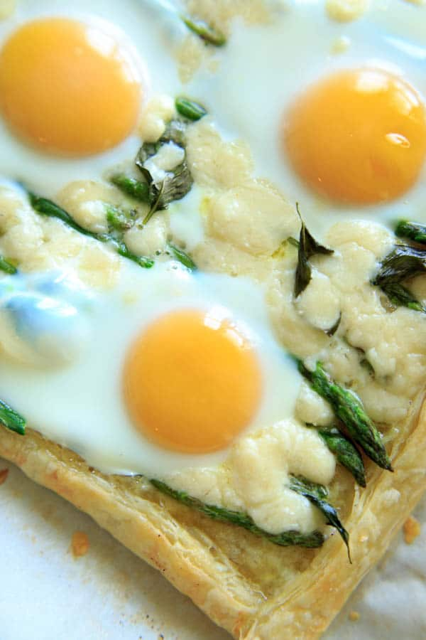 close-up of Asparagus Tart with Egg and Goat Cheese (on puff pastry)
