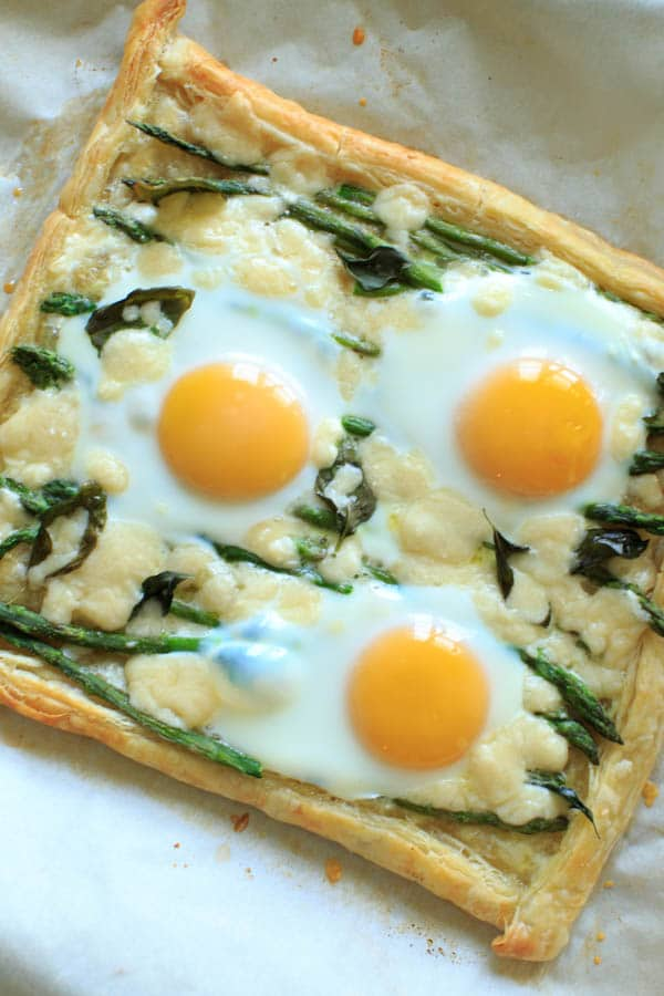 One sheet of puff pastry with asparagus, eggs and goat cheese