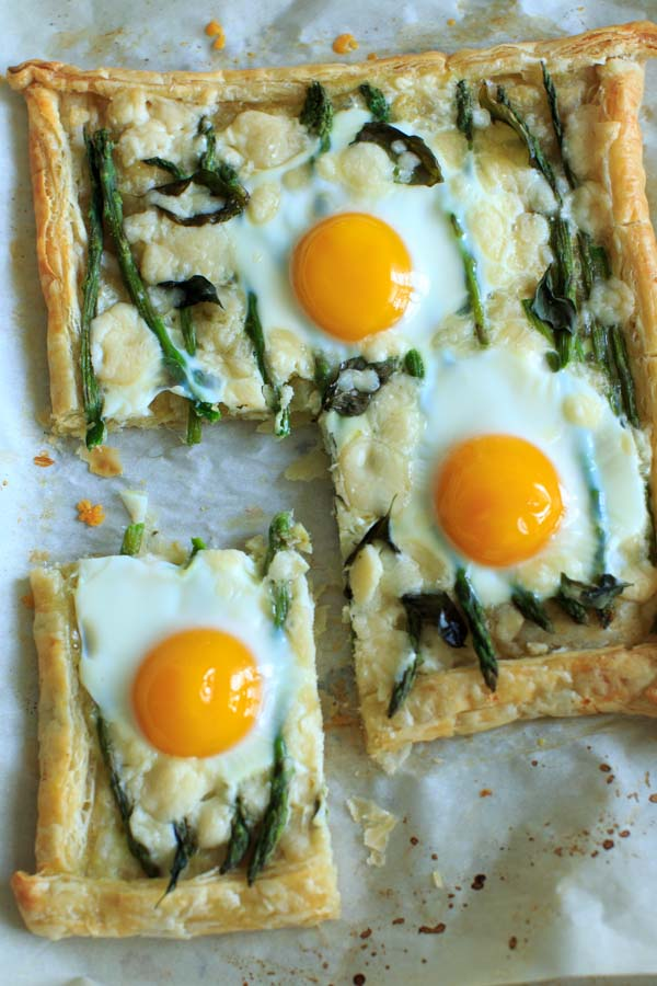 Asparagus Tart with Egg and Goat Cheese with a slice cut