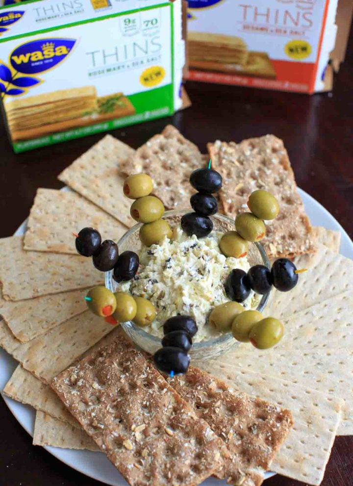 Olive goat cheese dip is a quick and simple appetizer that can be prepared ahead or on the spot. Sure to be a crowd pleaser!
