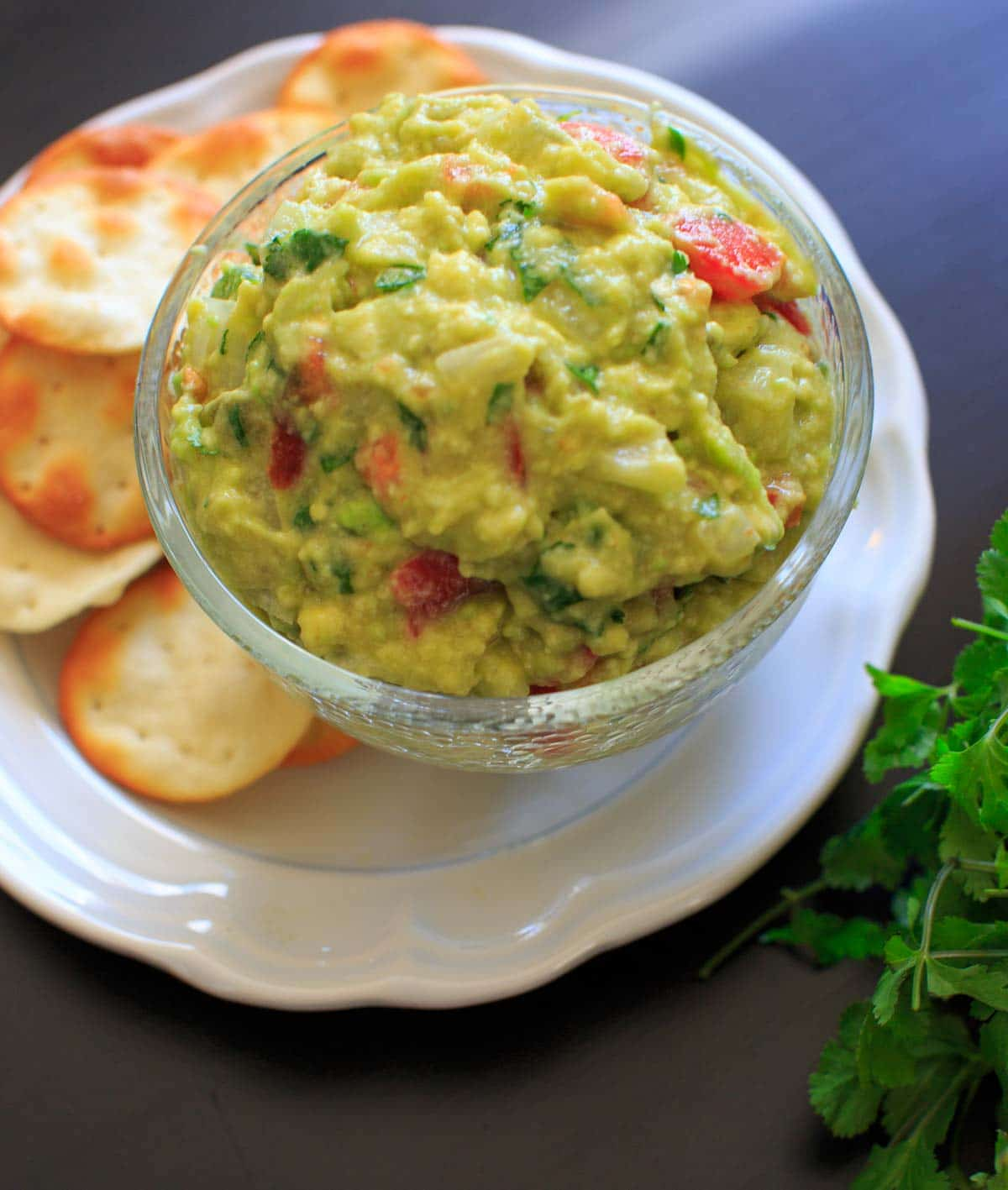 The BEST EVER guacamole recipe that's a little spicy, full of flavor and naturally vegan and gluten-free. Includes tips on how to make it your own if you need to modify.