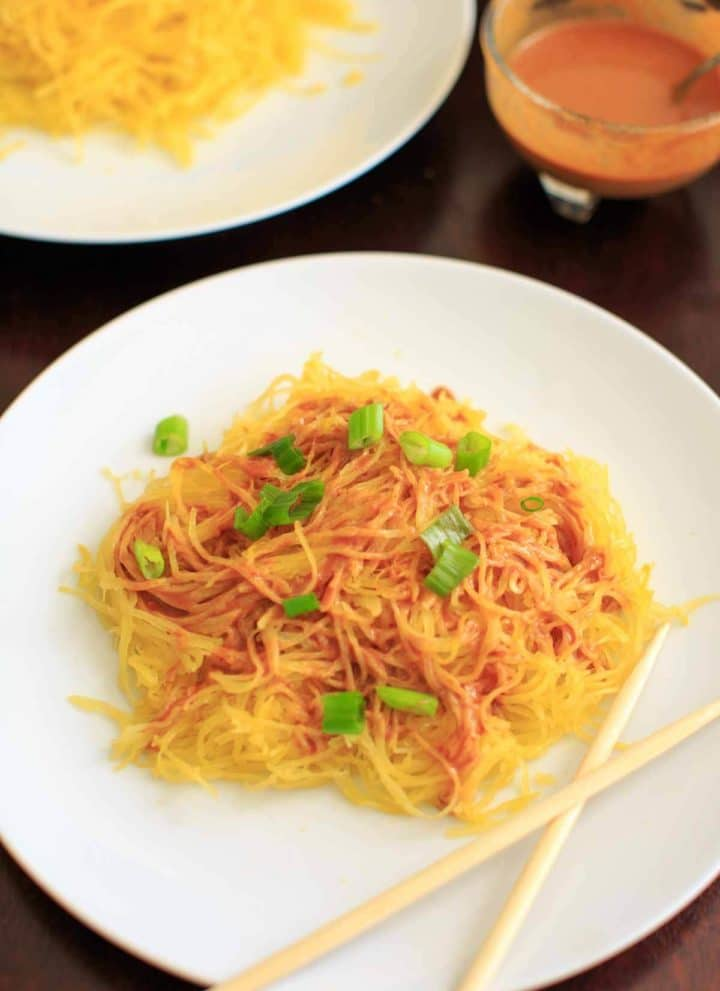 Spaghetti squash noodles and spicy peanut sauce make a delicious, gluten-free and vegan dinner that's easy to prepare!