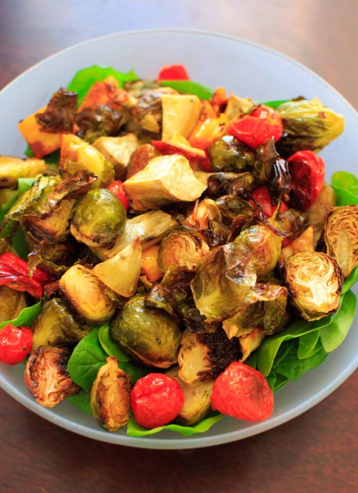 "Roasted Vegetable Spinach Salad with Avocado Dressing, a.k.a. ""Leftover Veggie Salad."" Use up your vegetables or roast your favorites for this healthy vegan meal!"