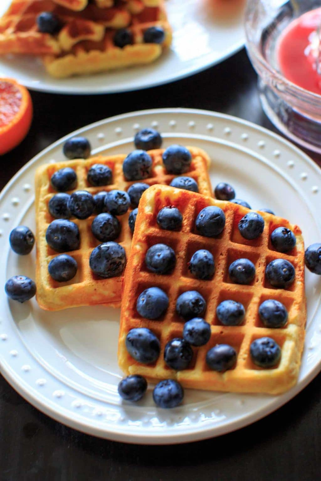 Belgian Waffles made healthy with split red lentils, blood orange juice and blueberries. Breakfast doesn't get any better than this!