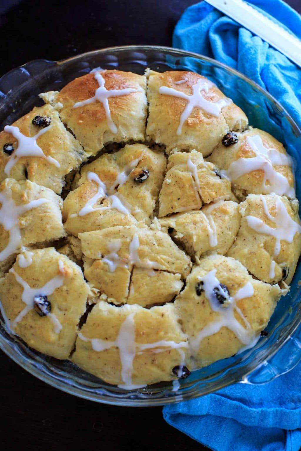 Hot Cross Buns with added dark chocolate pieces, dried cherries, and/or raisins.