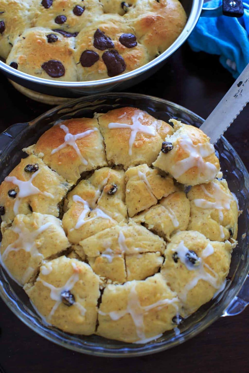 Hot Cross Buns with the options for added dark chocolate pieces and raisins and/or dried cherries. Makes two dozen.