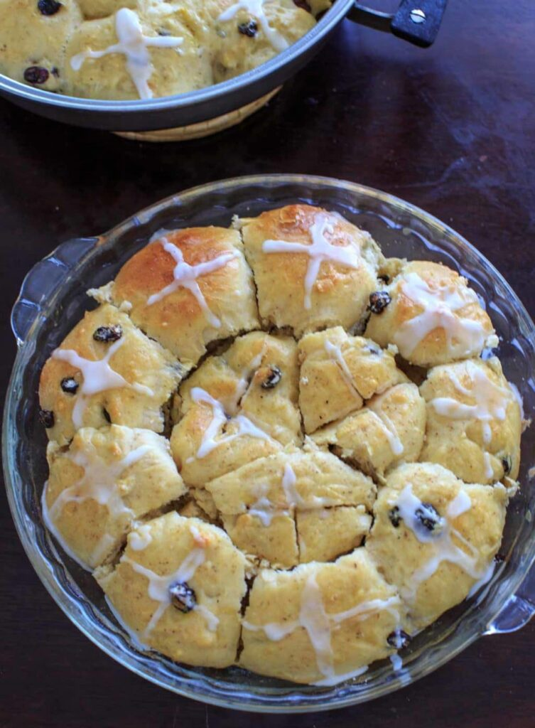 Hot Cross Buns with the options for added dark chocolate pieces and raisins and/or dried cherries.