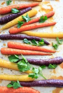 Maple roasted carrots are an easy vegetable side dish that you can throw together for any meal. Vegan and gluten-free, 5 ingredients or less. (Picture is after roasting with fresh parsley.)