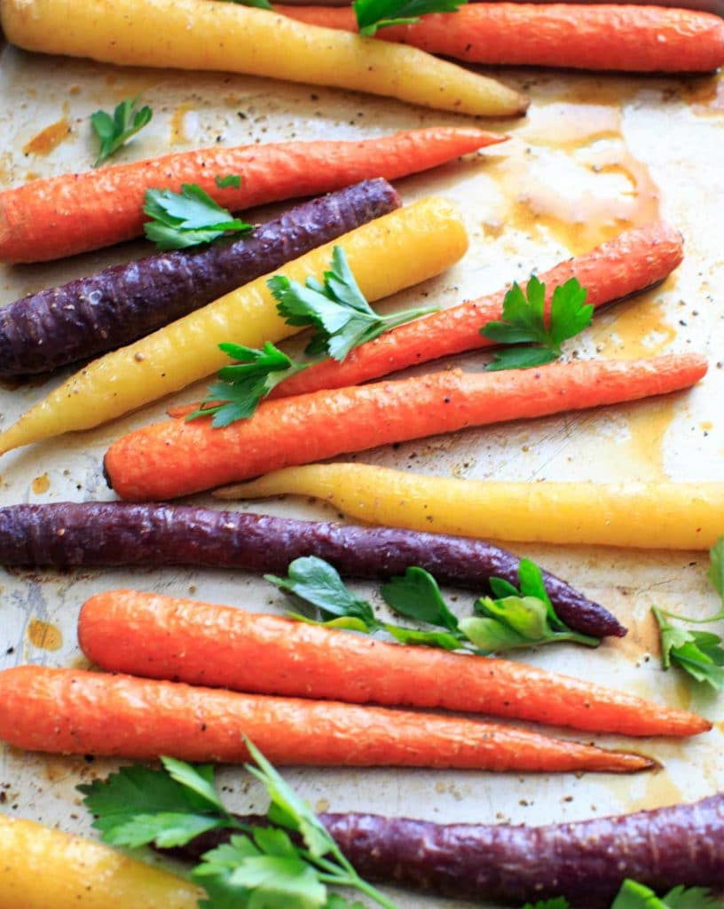 Maple roasted carrots are an easy vegetable side dish that you can throw together for any meal. Vegan and gluten-free, 5 ingredients or less. (Picture is after roasting with fresh parsley, final.)