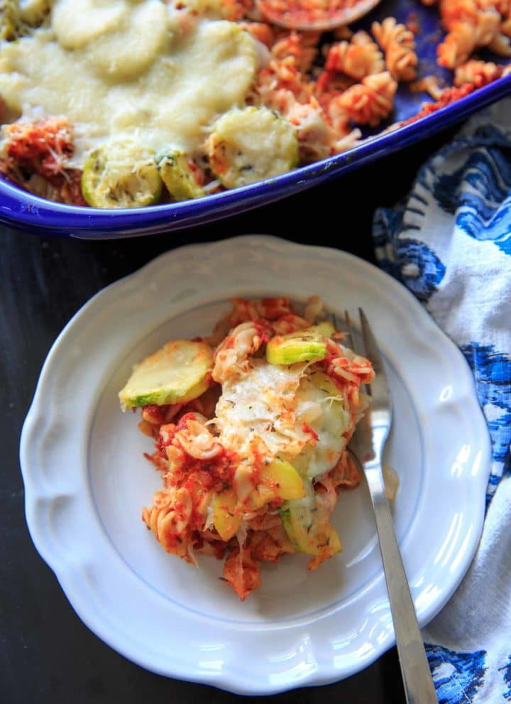 Zucchini Pasta Casserole with thyme. A super easy and healthy casserole that is easily gluten-free. With few ingredients (5 ingredients or less), dinner will be on the table in no time! Picture is plated single serving with full casserole in background.