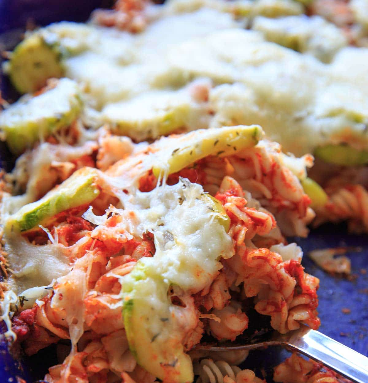Zucchini Pasta Casserole with thyme. A super easy and healthy casserole that is healthy and easily gluten-free. With few ingredients (5 ingredients or less), dinner will be on the table in no time! Up close shot of pasta casserole.