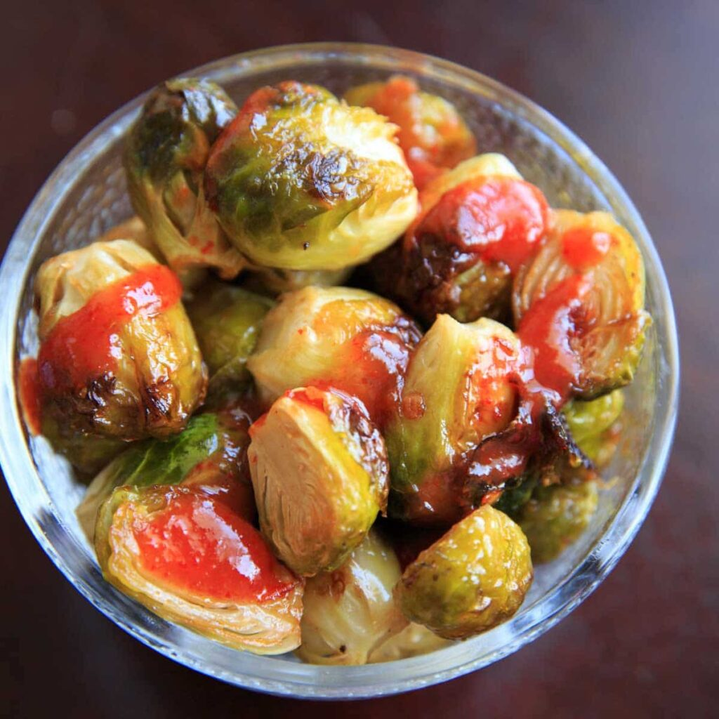 Bang Bang Brussels Sprouts. Easy and spicy side to liven up your veggies. (Pictured is roasted brussels sprouts with extra sriracha sauce.)