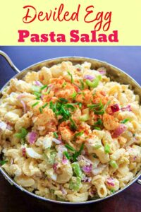 Deviled egg pasta salad with macaroni. Light on the mayo and big on flavor, this dish is a hit at cookouts or summer gatherings! Great way to use leftover hard boiled eggs.