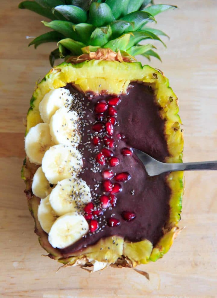 Pineapple Acai Smoothie Bowl or Boat. Lots of tropical fruit vibes and a handful of greens make this smoothie a refreshing treat! Superfoods + optional protein.