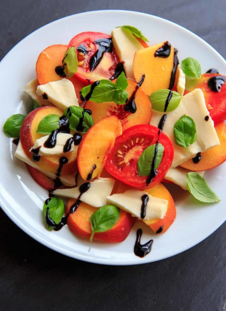 Peach Caprese Salad is a wonderful summer side dish, appetizer or even a meal! Mozzarella cheese, tomatoes, peaches and basil makes a fresh and satisfying dish.