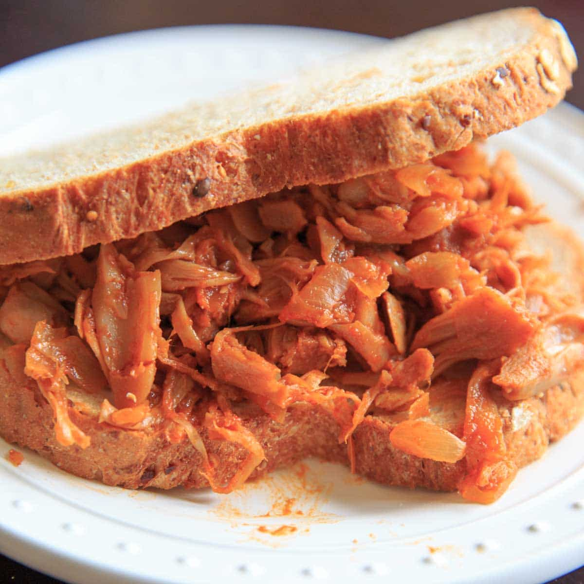 Vegan Pulled BBQ Jackfruit - eat it on a sandwich, in a taco, or by itself! Easy to make and customize based on your favorite flavor bbq sauce.