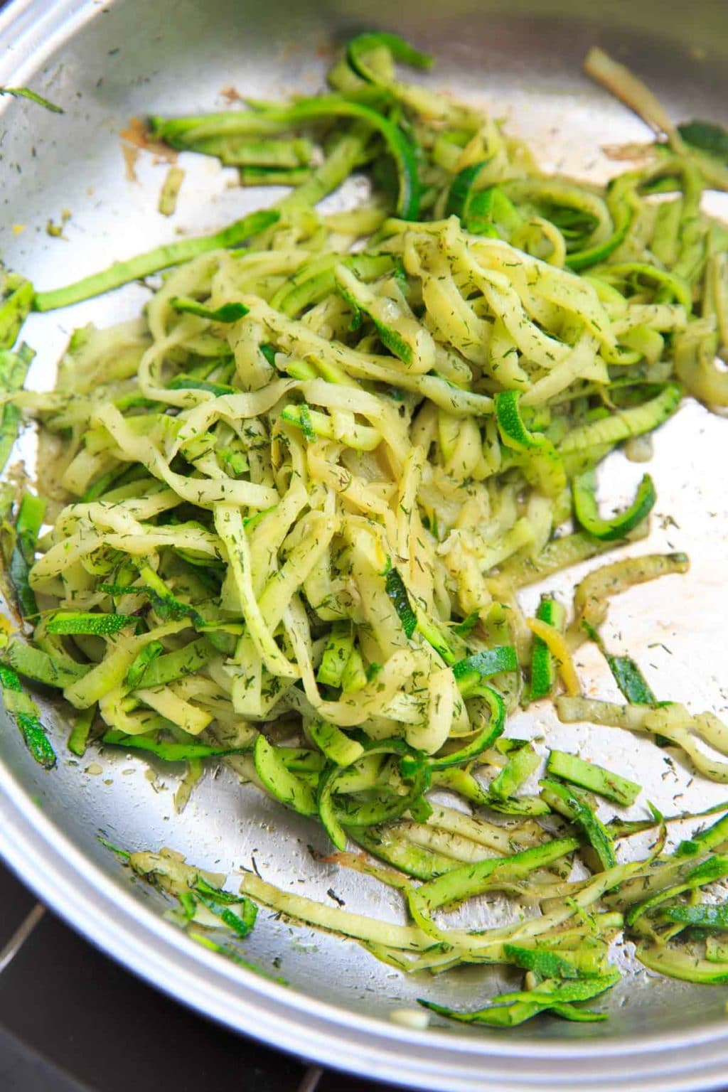 Cooked spiralized zucchini with dill