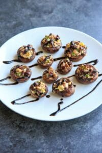 Chevre Stuffed Mushrooms with Sun-dried Tomatoes are an easy finger food or appetizer that is full of flavor! Option to mix it up with different flavors of goat cheese or sprinkle with herbs and balsamic vinegar.