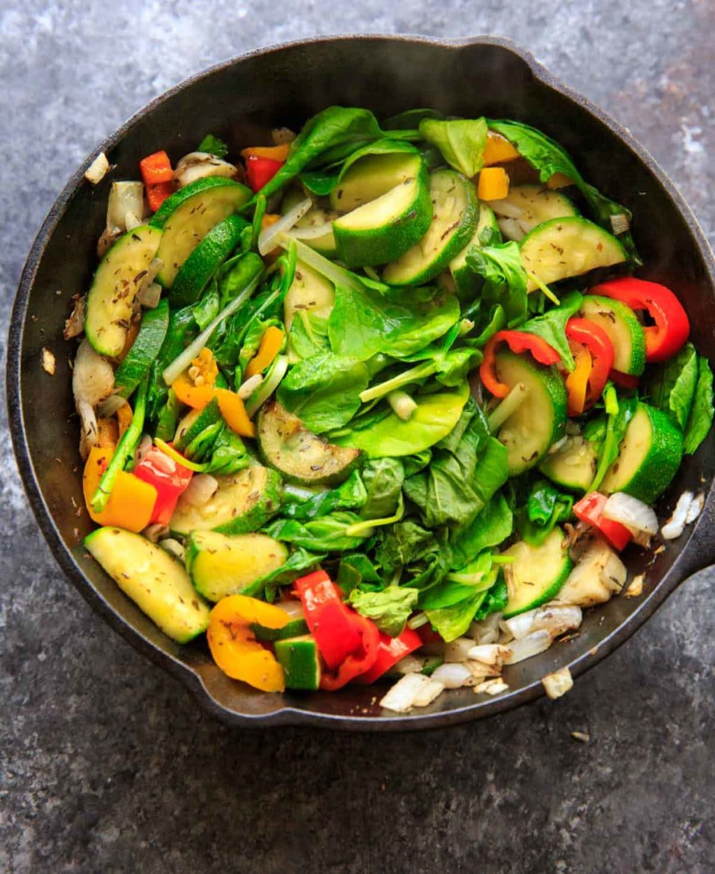 Sauteed vegetables with zucchini, onion, mini sweet peppers and spinach