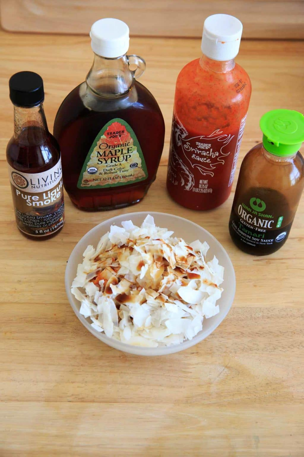 Coconut Chips with soy sauce or tamari, maple syrup, liquid smoke and a touch of sriracha. Before mixing