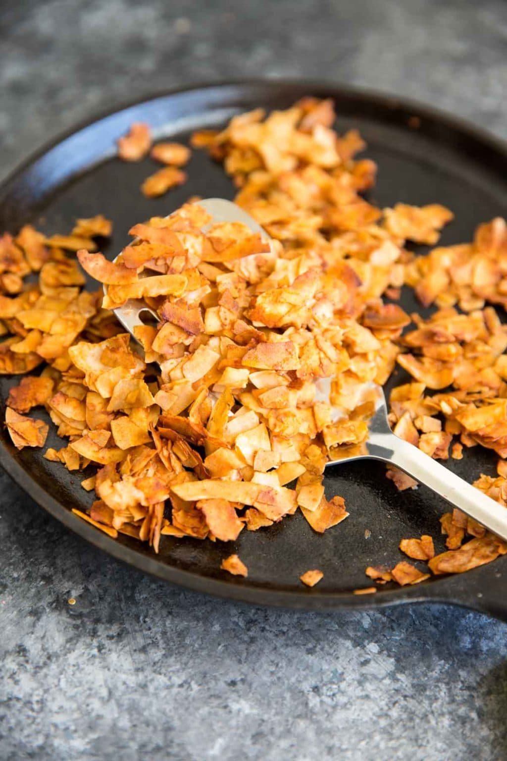 """Coconut Flake """"Bacon"""" - Coconut chips/flakes baked with soy sauce or tamari, maple syrup, liquid smoke and a touch of sriracha. Vegan bacon!"""