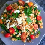 Green Bean Chickpea Salad with tomato, walnuts, feta cheese, parsley and lemon. A great appetizer or side dish for dinners or holiday gatherings!