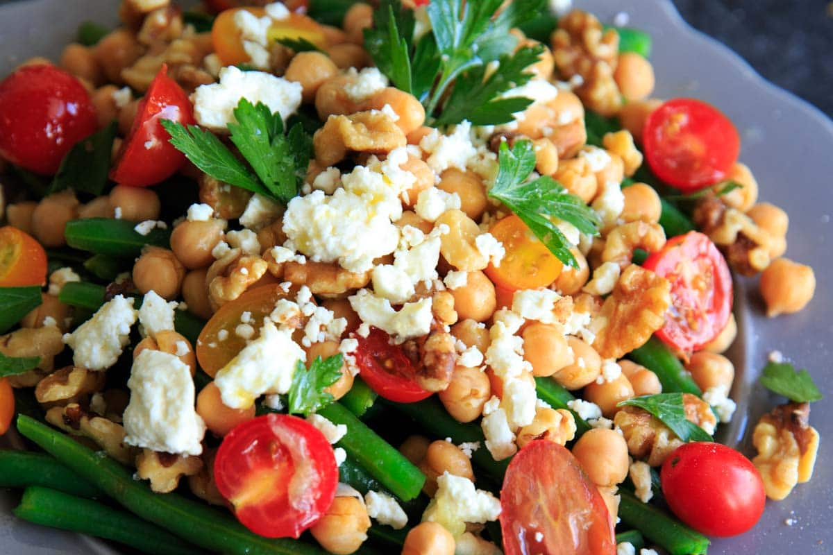 Green Bean Chickpea Salad with tomato, walnuts and feta. A great appetizer or side dish for dinners or holiday gatherings!
