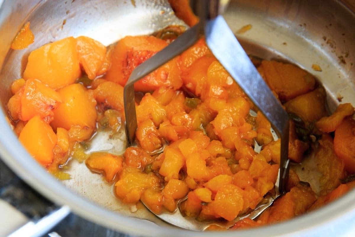 Peach Jalapeno Honey Baked Brie - mashing the peaches and jalapeno
