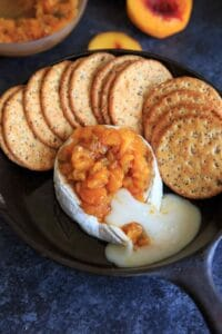 Peach Jalapeno Honey Baked Brie - a delicious party appetizer or game time food. Dip with crackers or veggies!