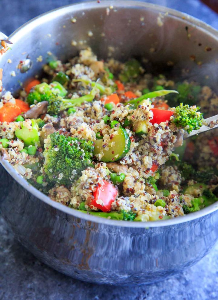 "Veggie Loaded Quinoa Fried ""Rice."" A delicious dinner packed with vegetables and full of flavor!"
