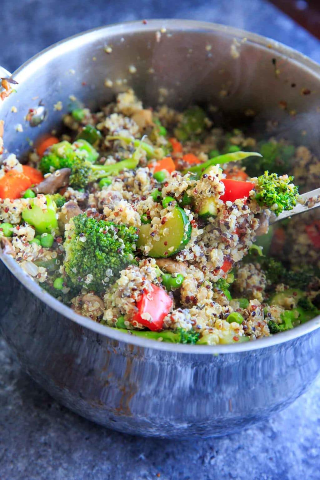 """Veggie Loaded Quinoa Fried """"Rice."""" A delicious dinner packed with vegetables and full of flavor!"""