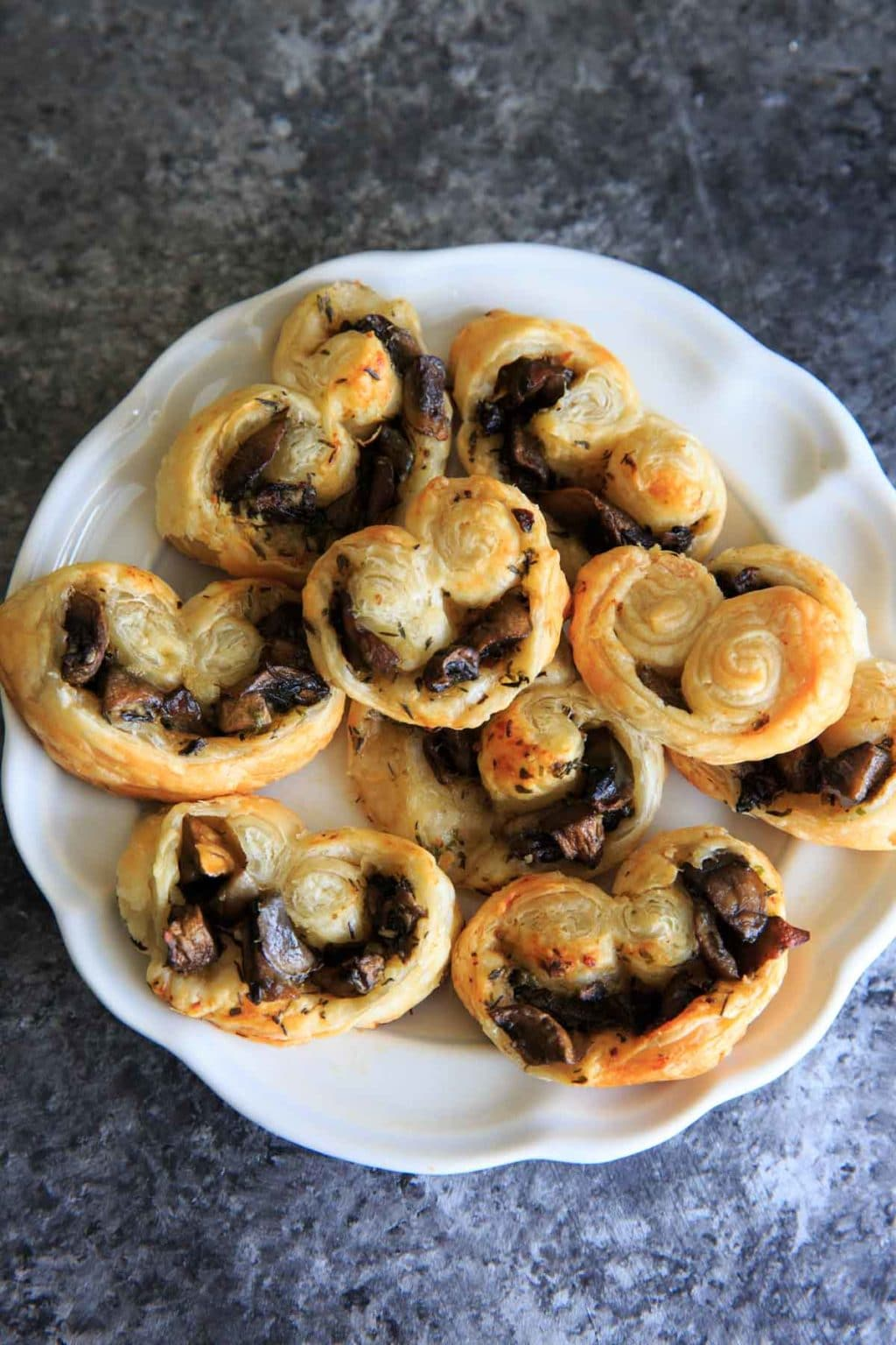 Savory Mushroom Palmiers - a savory version of the puff pastry treat that can be served as a delicious appetizer or side. Especially great for holidays or dinner parties!