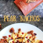 Sweet and savory pear nachos with glazes pecans, chevre cheese, pomegranate seeds and balsamic. A unique no-bake snack or dessert!