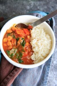 Pumpkin Chickpea Curry with Kale, served with rice or quinoa is a hearty vegan and gluten-free meal!