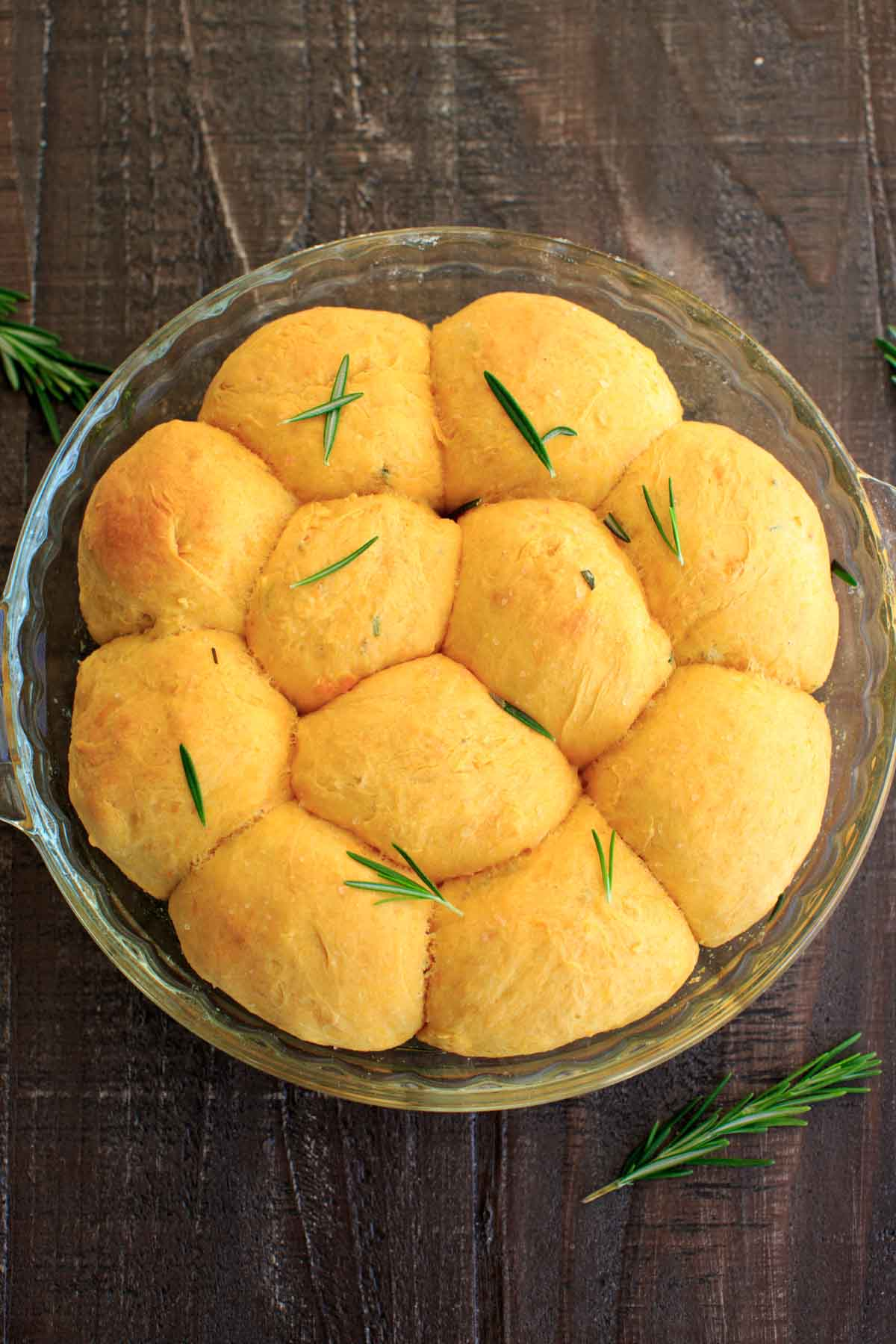 Rosemary Sweet Potato Dinner Rolls in glass baking dish